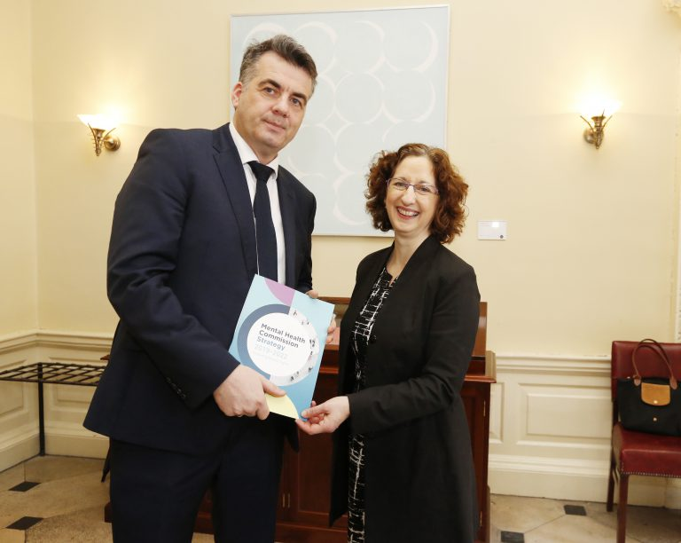 "Picture of John Farrelly, Chief Executive of the Mental Health Commission and Shari McDaid, Director of Mental Health Reform, holding a copy of the Mental Health Commissions publication, ""Protecting People's Rights"""